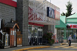 01 August 2012 - A woman exits a RONA store location in Surrey, B.C., Canada. Credit: Adrian Brown - N49Photo.