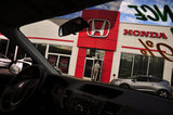 23 August 2012 - A man enters the showroom of White Rock Honda, in Surrey, B.C., Canada. Credit: Adrian Brown - N49Photo.