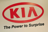 30 August 2012 - The Kia Motors name and logo is seen on the wall in the showroom at Applewood Kia, in Langley, B.C., Canada. Credit: Adrian Brown - N49Photo.