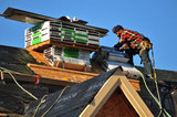 07 September 2012 - A worker is seen finishing the roof of a new home at a construction site in Surrey, B.C., Canada. Credit: Adrian Brown - N49Photo.