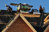 07 September 2012 - Workers are seen finishing the roof of a new home at a construction site in Surrey, B.C., Canada. Credit: Adrian Brown - N49Photo.