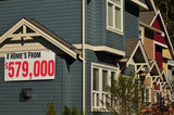 07 September 2012 - A sign advertising the cost of a new home is seen in a subdivision in Surrey, B.C., Canada. Credit: Adrian Brown - N49Photo.