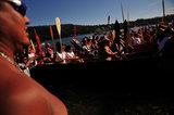 "01 September 2012 - People listen to others speak during a ceremony at Whey-Ah-Wichen (Cates Park), after travelling a ceremonial route by canoe from West Vancouver's Ambleside beach, in North Vancouver, B.C., Canada. The ""Gathering of Canoes to Protect the Salish Sea"" event, co-hosted by Squamish First Nation and Tsleil-Wauth First Nation, celebrated teachings of the canoe, future generations, unity of peoples, and reaffirmed each nation's responsibility to protect and maintain their sacred connection to the waters of the Salish Sea. The event was organized in opposition to the proposed expansion of the Kinder Morgan pipeline and tanker terminal, that could see increased super tanker traffic on Burrard inlet in Port Metro Vancouver. Credit: Adrian Brown - N49Photo."