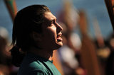 "01 September 2012 - A man speaks during a ceremony at Whey-Ah-Wichen (Cates Park), after travelling a ceremonial route by canoe from West Vancouver's Ambleside beach, in North Vancouver, B.C., Canada. The ""Gathering of Canoes to Protect the Salish Sea"" event, co-hosted by Squamish First Nation and Tsleil-Wauth First Nation, celebrated teachings of the canoe, future generations, unity of peoples, and reaffirmed each nation's responsibility to protect and maintain their sacred connection to the waters of the Salish Sea. The event was organized in opposition to the proposed expansion of the Kinder Morgan pipeline and tanker terminal, that could see increased super tanker traffic on Burrard inlet in Port Metro Vancouver. Credit: Adrian Brown - N49Photo."