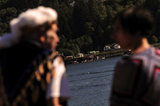 "01 September 2012 - People wait at Whey-Ah-Wichen (Cates Park), while a ceremony takes place across Burrard inlet near a terminal, after travelling a ceremonial route by canoe from West Vancouver's Ambleside beach, in North Vancouver, B.C., Canada. The ""Gathering of Canoes to Protect the Salish Sea"" event, co-hosted by Squamish First Nation and Tsleil-Wauth First Nation, celebrated teachings of the canoe, future generations, unity of peoples, and reaffirmed each nation's responsibility to protect and maintain their sacred connection to the waters of the Salish Sea. The event was organized in opposition to the proposed expansion of the Kinder Morgan pipeline and tanker terminal, that could see increased super tanker traffic on Burrard inlet in Port Metro Vancouver. Credit: Adrian Brown - N49Photo."