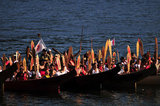 "01 September 2012 - People arrive by canoe at Whey-Ah-Wichen (Cates Park), after travelling a ceremonial route by canoe from West Vancouver's Ambleside beach, in North Vancouver, B.C., Canada. The ""Gathering of Canoes to Protect the Salish Sea"" event, co-hosted by Squamish First Nation and Tsleil-Wauth First Nation, celebrated teachings of the canoe, future generations, unity of peoples, and reaffirmed each nation's responsibility to protect and maintain their sacred connection to the waters of the Salish Sea. The event was organized in opposition to the proposed expansion of the Kinder Morgan pipeline and tanker terminal, that could see increased super tanker traffic on Burrard inlet in Port Metro Vancouver. Credit: Adrian Brown - N49Photo."