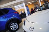 15 September 2012 - Mazda vehicles are seen in the showroom at Midway Mazda, in Surrey, B.C., Canada. Credit: Adrian Brown - N49Photo.