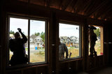 10 September 2012 - Workers install windows in a new home at a construction site only a few hundred metres from the USA border, and Washington State, in Surrey, B.C., Canada. Credit: Adrian Brown - N49Photo.