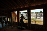 10 September 2012 - A worker installs a window in a new home at a construction site only a few hundred metres from the USA border, and Washington State, in Surrey, B.C., Canada. Credit: Adrian Brown - N49Photo.