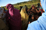 12 September 2012 - In a festive and happy mood at the end of the day after hand picking blueberries, female workers sing and dance in a field at Surrey Farms, in Surrey, B.C., Canada. Credit: Adrian Brown - N49Photo.
