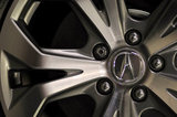 22 September 2012 - The Acura logo is seen on the rim of a vehicle in the showroom at the Acura of Langley dealership, in Langley, B.C., Canada. Credit: Adrian Brown - N49Photo.