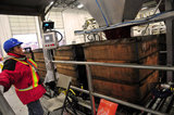 22 October 2012 - A worker operates a machine that fills totes with cranberries, before they are loaded into the back of a tractor trailer, at the brand new, state-of-the-art Ocean Spray of Canada Ltd., Richmond Receiving Station, in Richmond, B.C., Canada. Credit: Adrian Brown - N49Photo.