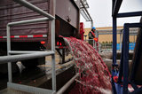 22 October 2012 - A worker watches as the flow of cranberries from a truck slows, at the brand new, state-of-the-art Ocean Spray of Canada Ltd., Richmond Receiving Station, in Richmond, B.C., Canada. Credit: Adrian Brown - N49Photo.