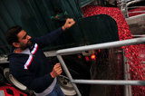 22 October 2012 - A truck driver opens the back of his truck to allow the flow of cranberries as it is filled with water, at the brand new, state-of-the-art Ocean Spray of Canada Ltd., Richmond Receiving Station, in Richmond, B.C., Canada. Credit: Adrian Brown - N49Photo.