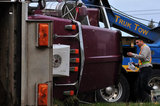 05 November 2012 - The driver of an overturned truck on Highway 99, walks past the scene of the accident, in Surrey, B.C., Canada. While an investigation will take place, it is believed that the right front tire of the truck blew out, causing the truck to veer off the shoulder, rolling onto its side in a grassy area beside the highway. The driver was unhurt at the scene. Credit: Adrian Brown - N49Photo.