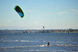 25 September 2013 - White Rock, B.C., Canada - A man kiteboards in front of East Beach, on the Semiahmoo First Nation reserve just south of the city of White Rock. Drayton Harbor and the US coastline are seen in the distance, in Blaine, WA, centre left. Photo Credit: Adrian Brown / Sipa Press.